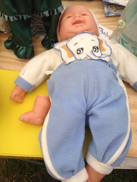 #2 - the baby doll who has no problem sticking its foot in its mouth
